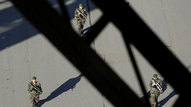 French soldiers patrol under the Eiffel Tower in Paris (AP)