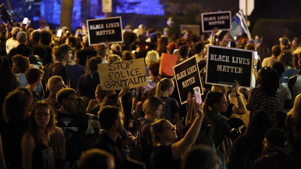 Protesters gather after a judge found the former St Louis police officer not guilty of first-degree murder (AP)