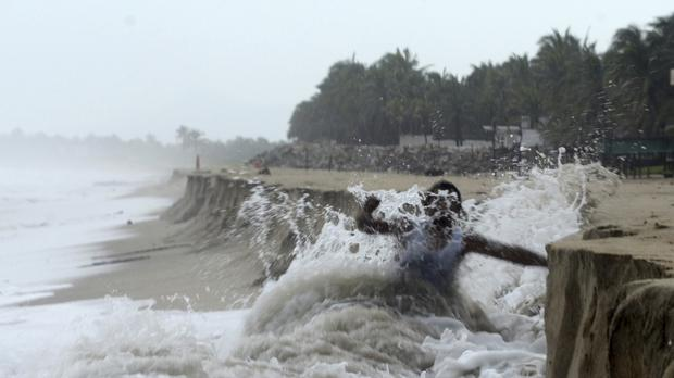 A man fights against waves caused by approaching Hurricane Max on the outskirts of Acapulco, Guerrero state (AP Photo/Bernandino Hernandez)