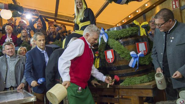Munich's Mayor Dieter Reiter taps the first beer barrel