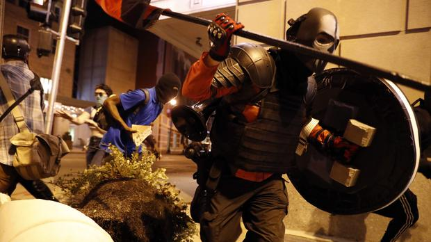 Violent protests took place following largely peaceful demonstrations during the day (AP)