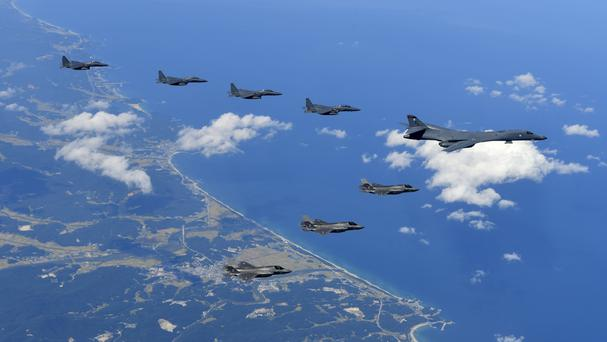 US Air Force B-1B bomber, F-35B stealth fighter jets and South Korean F-15K fighter jets fly over the Korean Peninsula during a joint drills (South Korea defence ministry/AP)