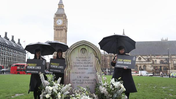 Amnesty International activists erect a 6ft gravestone in Parliament Square in memory of thousands of Yemeni civilians killed by air strikes