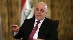 Iraq's prime minister Haider al-Abadi had said previously that he is prepared to intervene militarily if the Kurdish region's planned referendum results in violence (AP)