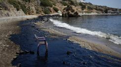 A polluted beach after an oil spill on the island of Salamina, Greece, near Athens (AP)