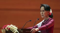 Aung San Suu Kyi delivers a televised speech to the nation (AP Photo/Aung Shine Oo)