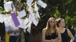 Notes written by mourners are attached to a tree at a memorial for Georgia Tech student Scout Schultz in Atlanta. (AP)