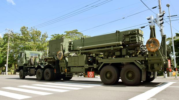 A Patriot Advanced Capability-3 interceptor missile system (PAC3) is transported to the Hakodate base of Japan's Self-Defence Forces (AP)