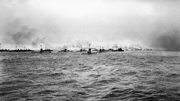 A flotilla of German submarines (U-Boats) and torpedo boats heading out to sea
