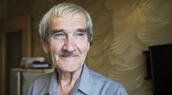 Former Soviet missile defence forces officer Stanislav Petrov poses for a photo at his home in Fryazino, Moscow region, Russia (AP)