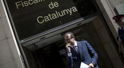 The mayor of Mollerussa, Marc Solsona leaves legal headquarters in Catalonia (AP)