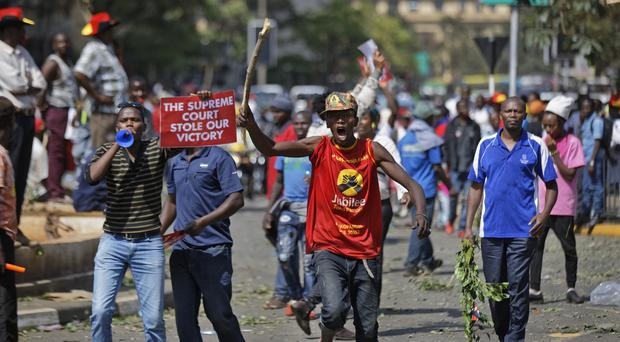 Supporters of President Uhuru Kenyatta, angry at the Supreme Court's nullification earlier this month of the August presidential election (AP)