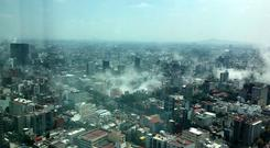 View from window shows plumes of dust in Mexico City after earthquake (Francisco Caballero Gout/AP)