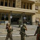 Russian servicemen outside a hospital in Deir el-Zour, Syria