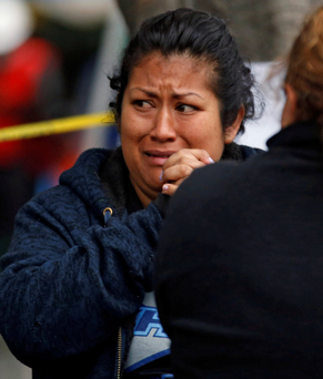 Relatives wait for news of their loved ones as they react next to a collapsed building after an earthquake in Mexico City. Photo: Reuters
