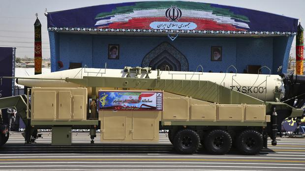 Iran defies US by unveiling latest missile during military