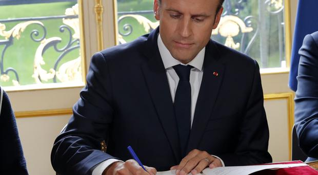 Macron signs decrees to implement controversial labour reforms in France