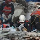 Rescue personnel in the rubble of a building in the Ciudad Jardin neighbourhood of Mexico City (AP)