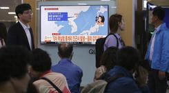 People watch a reporting of North Korea's earthquake at Seoul Railway Station in South Korea (AP/Ahn Young-joon)