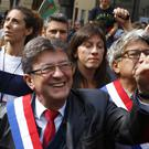 Jean-Luc Melenchon greets supporters as he arrives to take part in a demonstration in Paris (AP/Francois Mori)