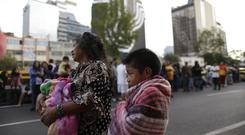 People in the street after an earthquake alarm in Mexico City (AP/Natacha Pisarenko)