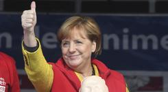 German Chancellor Angela Merkel campaigns in Greifswald (Stefan Sauer/dpa via AP)