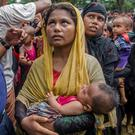 Rohingya women and children queue for aid at Balukhali camp in Bangladesh. Photo: Dar Yasin/AP
