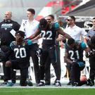 Jacksonville Jaguars players kneel in protest during the national anthem at Wembley Stadium