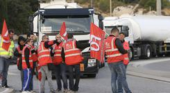 Members of the FO union install a blockade at La Mede Total refinery, in Chateauneuf-La Mede (AP/Claude Paris)