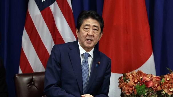 Support for Mr Abe's government has increased over the summer (AP)