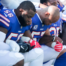 Buffalo Bills players take a knee during the anthem prior to their NFL game on Sunday. Photo: Getty Images