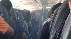 Mobile phone video shows smoke inside an Allegiant Air jet after it landed at Fresno Yosemite International Airport in California (Estevan Moreno/AP)