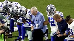 The Dallas Cowboys, led by owner Jerry Jones, take a knee prior to the national anthem at an NFL football game against the Arizona Cardinals (AP)