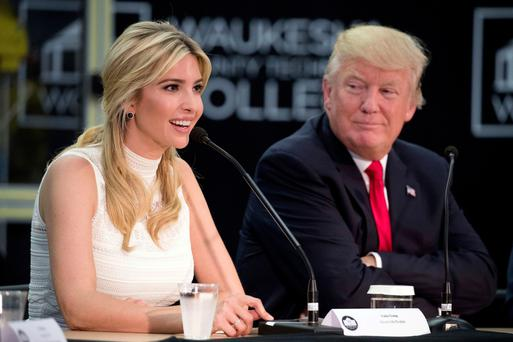 Donald Trump listens to daughter Ivanka speaks at a workforce development event in Wisconsin earlier this year. Photo: AP/Andrew Harnik