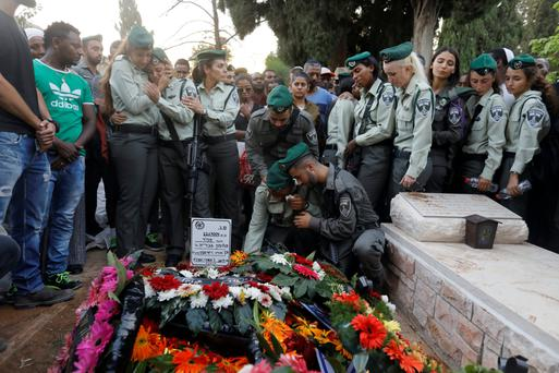 Relatives and friends of Solomon Gavria, one of three Israeli guards killed in a Palestinian shooting attack, mourn during his funeral. Photo: Reuters