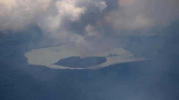 Huge columns of smoke, ash and rocks billow from the crater of the Manaro volcano on Vanuatu's Ambae Island (New Zealand Defence Force via AP)