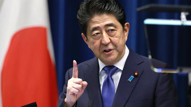 Japanese PM Shinzo Abe is seeking a public mandate on his tougher diplomatic and defence policies to deal with escalating threats from North Korea (AP Photo/Shizuo Kambayashi)