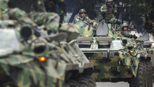 File picture of armed vehicles at a militant siege in Bangladesh (AP)