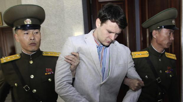 File photo of American student Otto Warmbier, who has since died, being escorted at the Supreme Court in Pyongyang, North Korea (AP)