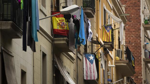 Balconies decorated with Esteladas or pro independence flags and also a Spanish flag are seen in Barcelona, Spain (AP)