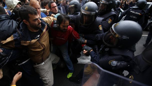 Pro-referendum supporters clash with Spanish riot police (AP)