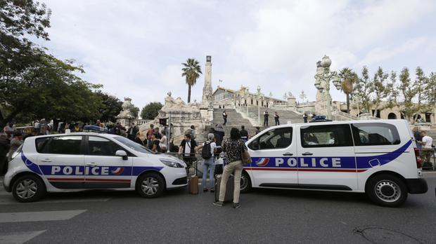 Police cars parked outside the Marseille railway station (AP)
