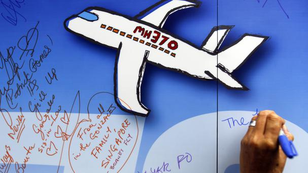 Messages are written on a wall of hope during a remembrance event for missing Malaysia Airlines Flight 370 in Kuala Lumpur (AP Photo/Joshua Paul, File)