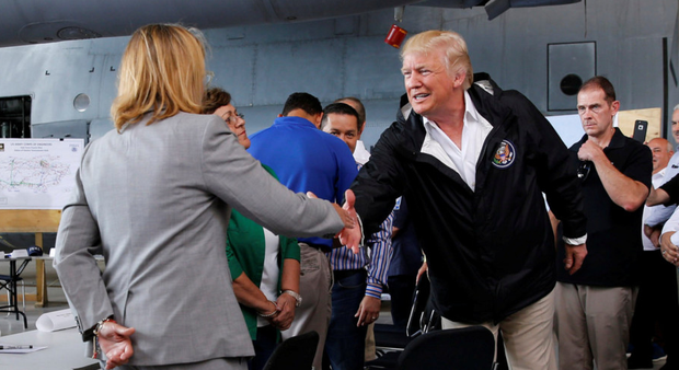 US President Donald Trump shakes hands with San Juan Mayor Carmen Yulin Cruz. Photo: Reuters/Jonathan Ernst