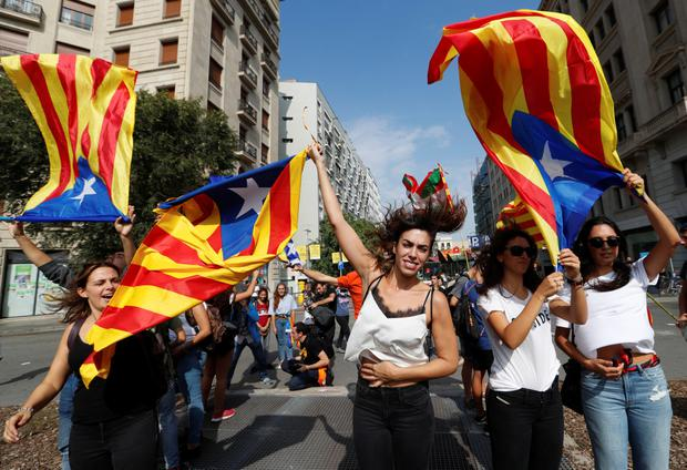 People hold Catalan separatist flags during a demonstration in Barcelona. Photo: Yves Herman/Reuters