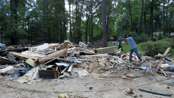 Workers continue clearing debris from the home of Houston resident Chris Slaughter, whose house in the suburb of Kingwood was flooded by 5.5 feet of water during Harvey's torrential rainfall. (AP)