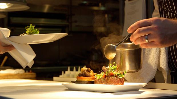 A chef putting the finishing touches to a meal, as the latest economic data for the services sector is released