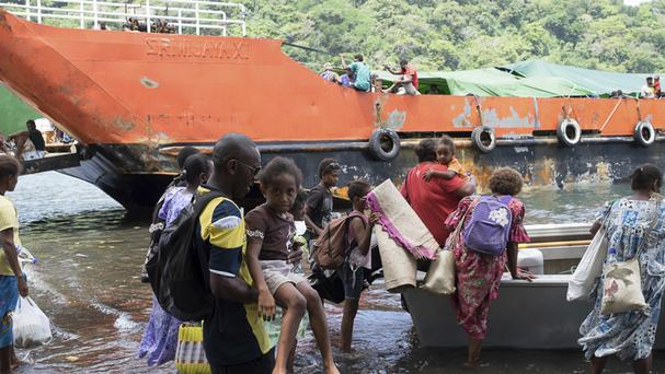 Residents prepare to evacuate from Ambae Island in Vanuatu amid fears of a volcanic eruption (Red Cross/AP)