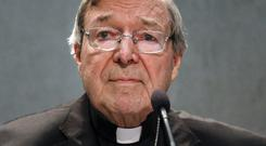 Cardinal George Pell, the most senior Catholic official to face sex offence charges, was jeered by protesters as he made a court appearance on Friday. (AP)