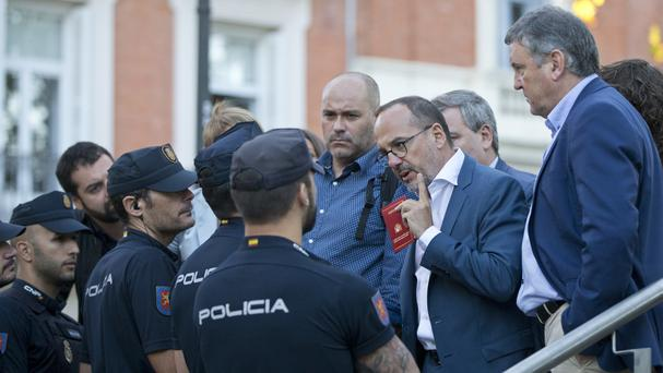 Parliamentary deputies argue with police who would not let them get close when Catalan regional police chief Josep Luis Trapero arrived at the national court in Madrid (AP Photo/Paul White)